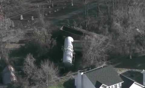 Nine rail cars of a 92 car BNSF train derailed in Imperial, MO along a section of track running between cemetary plots on one side and residential homes on the other.