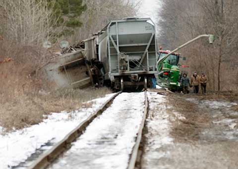 A train derailed in Saginaw Township, MI spilling a load of grain alongside the tracks on February 9, 2013. Photo credit: Jeff Schrier / Mlive.com.