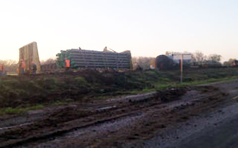 A view of the train accident and derailment at dawn on March 19, 2013 in North Zulch, TX following a collision with a chicken truck the night before on March 18, 2013. and Photo credit: KBTX.com