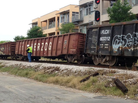 A freight train derailed in Austin, TX on April 3, 2013 causing delays for Capital Metro Rail passengers and vehicle traffic. It will take days for repair crews to repair the damage to the tracks. Photo credit: Jessica Vess / KVUE