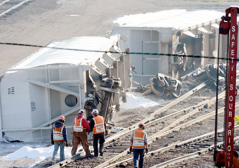 Three rail cars belonging to the Wheeling and Lake Erie Railroad derailed and then tipped over in a rail yard in Canton, OH on April 26, 2013. Photo credit: Cantonrep.com