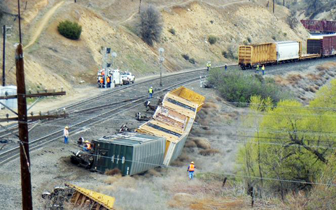 Several rail cars lay tipped over on their sides after a major Union Pacific train derailment just west of Tehachapi, CA on April 7, 2013. Photo credit: Phil Cornyn / Tehachapi News