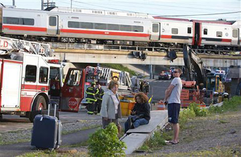 Two Amtrak trains collided in Bridgeport, CT near the border with Faifield, CT on May 13, 2013 injuring dozens. Photo credit:  Michelle McLoughlin / Reuters
