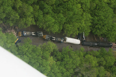 An eastbound Canadian Pacific train derailed in Charles City, IA when a section of track was washed out by recent flooding on May 21, 2013. Photo credit: (Arian Schuessler/The Globe Gazette.