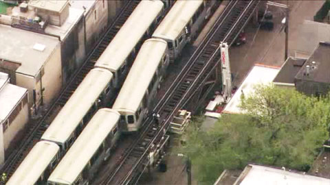 A passenger car on the CTA Red Line in Chicago, IL jumped the tracks on May 9 2013. One passenger had to be rescued by the Chicago Fire Department using an elevated bucket.