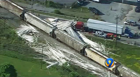 A CSX train plowed into a semi truck that was stopped on the tracks at a rail crossing in Monroe, NC on April 30, 2013 and spilled a load of PVC pipe all over the surrounding area.