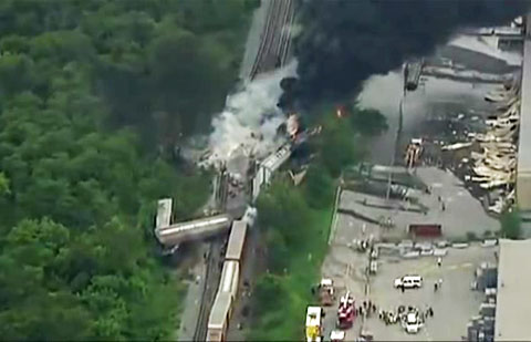 A CSX train derailed and exploded after hitting a trash truck in an industrial area of Rosedale, MD on May 28, 2013. The force of the explosion was so violent that the photo shows the metal siding was blown off a nearby warehouse next to the tracks.