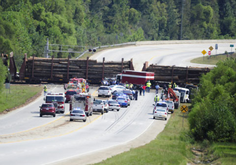 Hazmat and emergency crews responding at the scene of a Norfolk Southern train derailment after a collision with a semi truck in McBean, GA on September 17, 2013. Photo credit: Michael Holahan / Augusta Chronicle