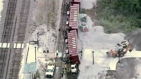 A railroad worker was killed when he was crushed by a rail car filled with tons of gravel in train accident and derailment in Sanford, FL on October 24, 2013.