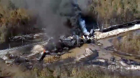 A train carrying tankers of crude oil derailed while crossing a wooden trestle in a western Alabama wetlands causing an explosion and fire on November 8, 2013.